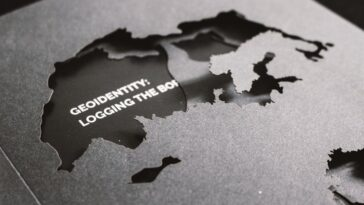 world map cutout in black with project title geoidentity: logging the boarders. Goodvertsing article by Nobantu Modise
